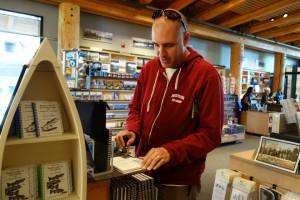 Craig stamping our passport at the Craig Thomas Discovery & Visitor Center in Grand Teton National Park.